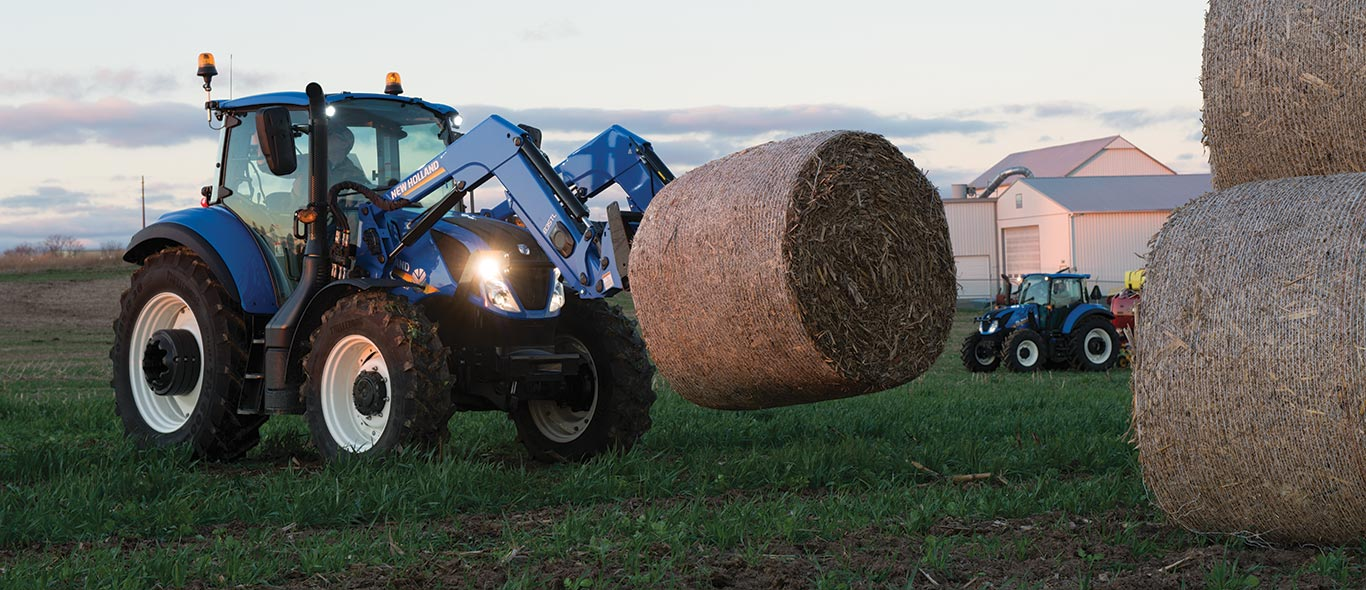 New Holland Tractor Moving Hay