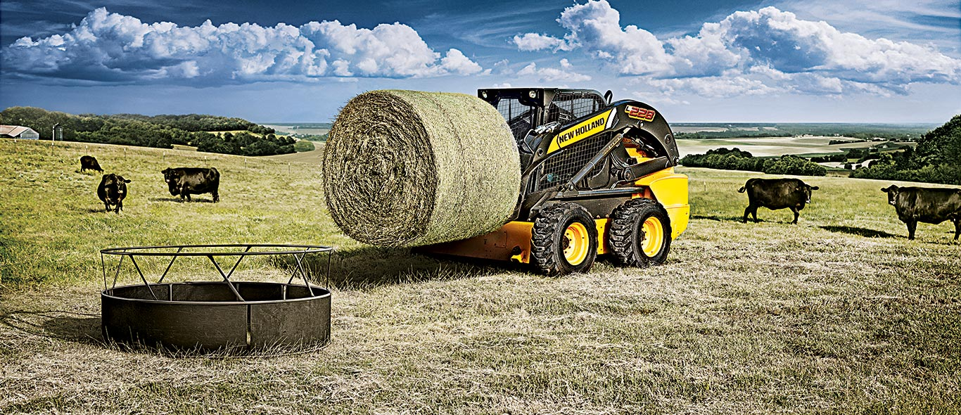 New Holland Skid Steer Moving Hay