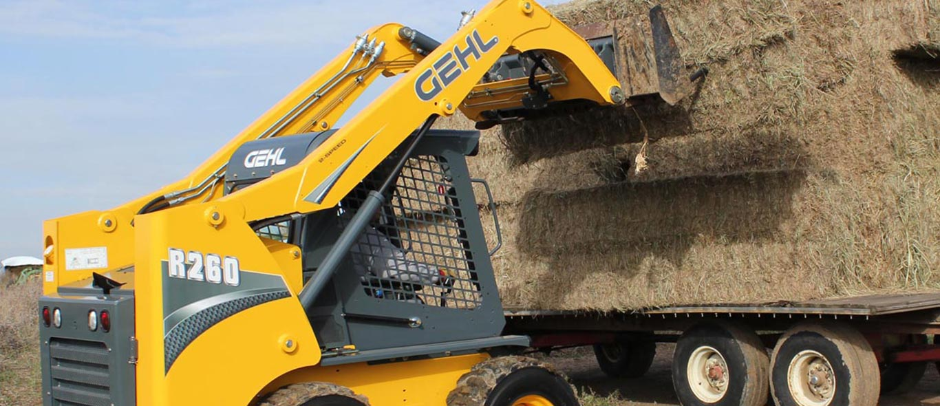 Gehl Skid Steer Moving Hay